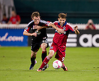 Mike Magee (9) of the Chicago Fire fights for the ball with Jared Jeffrey (25) of D.C. United during a Major League Soccer game at RFK Stadium in Washington, DC.  The Chicago Fire defeated D.C. United, 3-0.