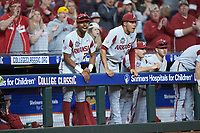 (L-R) Curtis Washington, Jr. (22) and Bryce Matthews (24) of the Arkansas Razorbacks cheer for their team from the top step of the dugout during the game against the Texas Longhorns in game six of the 2020 Shriners Hospitals for Children College Classic at Minute Maid Park on February 28, 2020 in Houston, Texas. The Longhorns defeated the Razorbacks 8-7. (Brian Westerholt/Four Seam Images)