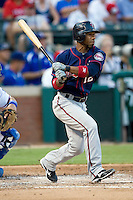 Minnesota Twins second baseman Alexi Casilla #12 at bat during a Major League Baseball game against the Texas Rangers at the Rangers Ballpark in Arlington, Texas on July 27, 2011. Minnesota defeated Texas 7-2.  (Andrew Woolley/Four Seam Images)