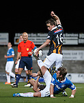 David Templeton hooks the ball away from Lewis Barr