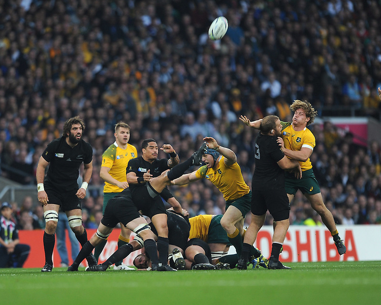 Aaron Smith of New Zealand sends up a box kick as Owen Franks of New Zealand blocks the challenge of Michael Hooper of Australia during the Rugby World Cup Final between New Zealand and Australia - 31/10/2015 - Twickenham Stadium, London<br /> Mandatory Credit: Rob Munro/Stewart Communications