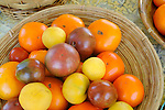 Williamsport Growers Market. Yellow garden peach tomato, persimmon, purple cherokee tomato.