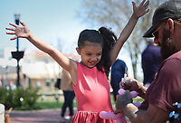 Jonni Crite, 5, of Bella Vista (from left)reacts as Anthony Kellington of Eureka Springs makes a balloon animals, Sunday, April 4, 2021 at the downtown square in Bentonville. Check out nwaonline.com/210405Daily/ for today's photo gallery. <br /> (NWA Democrat-Gazette/Charlie Kaijo)