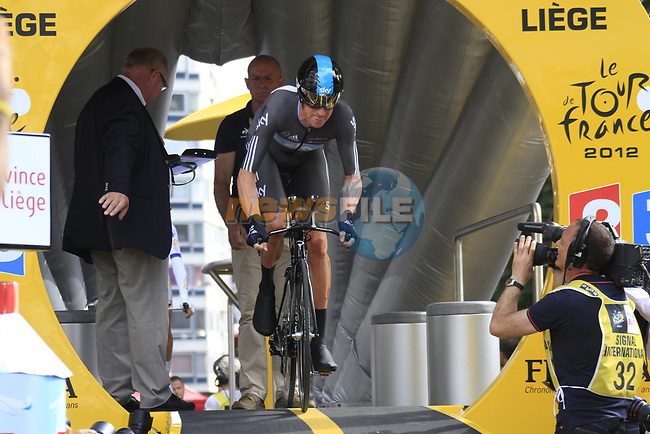 Bradley Wiggins (GBR) Sky Procycling powers off the start ramp of the Prologue of the 99th edition of the Tour de France 2012, a 6.4km individual time trial starting in Parc d'Avroy, Liege, Belgium. 30th June 2012.<br /> (Photo by Eoin Clarke/NEWSFILE)