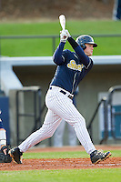 Trevor Edwards (33) of the UNCG Spartans follows through on his swing against the Georgia Southern Eagles at UNCG Baseball Stadium on March 29, 2013 in Greensboro, North Carolina.  The Spartans defeated the Eagles 5-4.  (Brian Westerholt/Four Seam Images)