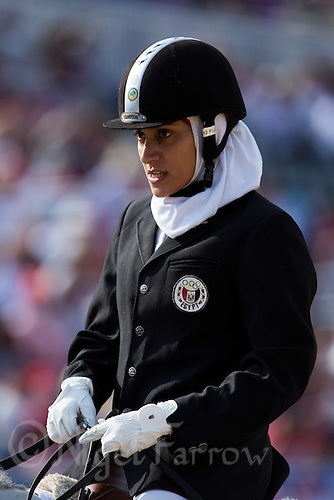 12 AUG 2012 - LONDON, GBR - Aya Medany (EGY) of Egypt walks her horse Udea after completing her round during the women's London 2012 Olympic Games Modern Pentathlon riding in Greenwich Park, Greenwich, London, Great Britain .(PHOTO (C) 2012 NIGEL FARROW)