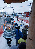 """Lachlan Clarke runs up the finish chute at  Nome as the """"widows lamp"""" burns for the last musher to arrive on Sunday  March 22, 2015 during Iditarod 2015.  <br /> <br /> (C) Jeff Schultz/SchultzPhoto.com - ALL RIGHTS RESERVED<br />  DUPLICATION  PROHIBITED  WITHOUT  PERMISSION"""
