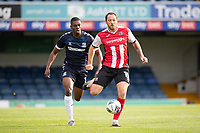 Tom Parkes of Exeter City wins the sprint with Emile Acquah, Southend United  for the through ball and plays back to safety during Southend United vs Exeter City, Sky Bet EFL League 2 Football at Roots Hall on 10th October 2020