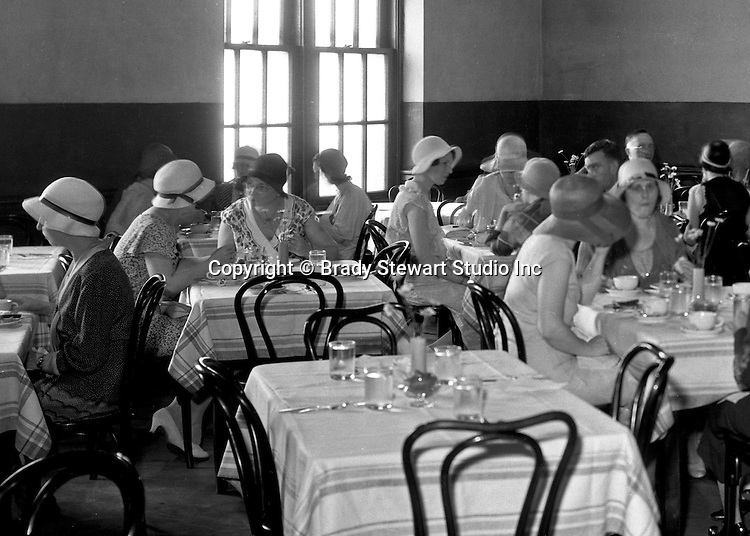 Pittsburgh PA:  Faculty and students having lunch at the Duquesne University cafeteria.