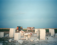 Dusk falls on Koshkar-Ata 'City of the Dead'. At this cemetery, grave builders set up temporary home on site so that they can work all hours of the day.