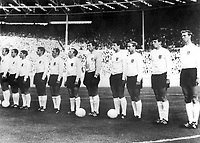 30.07.1966 Wembley Stadium, London England. World Cup Final. England team line up for the national anthem at Wembley versus Germany. Players L-R Bobby Moore, George Cohen, Alan Ball, Roger Hunt, Ray Wilson, Nobby Stiles, Gordon Banks, Geoff Hurst, Bobby Charlton, Martin Peters and Jackie Charlton.