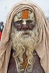 Portrait on a Sadhu after after holy bath in the Ganges River in Allahabad for Kumbh Mela Festival.