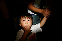 CHINA. Beijing. A young girl on Tiananmen Square during the Beijing 2008 Summer Olympics. 2008