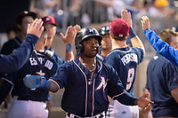 Northwest Arkansas Naturals outfielder D.J. Burt (1) is congratulated after scoring a run during a Texas League game between the Northwest Arkansas Naturals and the Arkansas Travelers on May 30, 2019 at Arvest Ballpark in Springdale, Arkansas. (Jason Ivester/Four Seam Images)