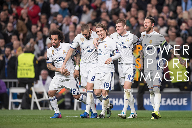 Real Madrid team celebrates during the match Real Madrid vs Napoli, part of the 2016-17 UEFA Champions League Round of 16 at the Santiago Bernabeu Stadium on 15 February 2017 in Madrid, Spain. Photo by Diego Gonzalez Souto / Power Sport Images