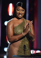 """HOLLYWOOD, CA - MAY 27: Megan Thee Stallion accepts the Best Collaboration Award at the 2021 """"iHeartRadio Music Awards"""" airing live from The Dolby Theatre in Los Angeles, Thursday, May 27 (8:00-10:00 PM ET live / PT tape-delayed) on FOX.  (Photo by Frank Micelotta/FOX/PictureGroup)"""