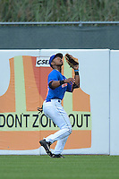 Outfielder Norman Howard (5) of Central High School in Phoenix City, Alabama playing for the New York Mets scout team during the East Coast Pro Showcase on August 1, 2013 at NBT Bank Stadium in Syracuse, New York.  (Mike Janes/Four Seam Images)