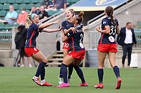 CARY, NC - APRIL 10: Trinity Rodman #2 of the Washington Spirit celebrates her first professional goal with teammates Ashley Sanchez #10, Natalie Jacobs #4, and Ashley Hatch #33 during a game between Washington Spirit and North Carolina Courage at Sahlen's Stadium at WakeMed Soccer Park on April 10, 2021 in Cary, North Carolina.