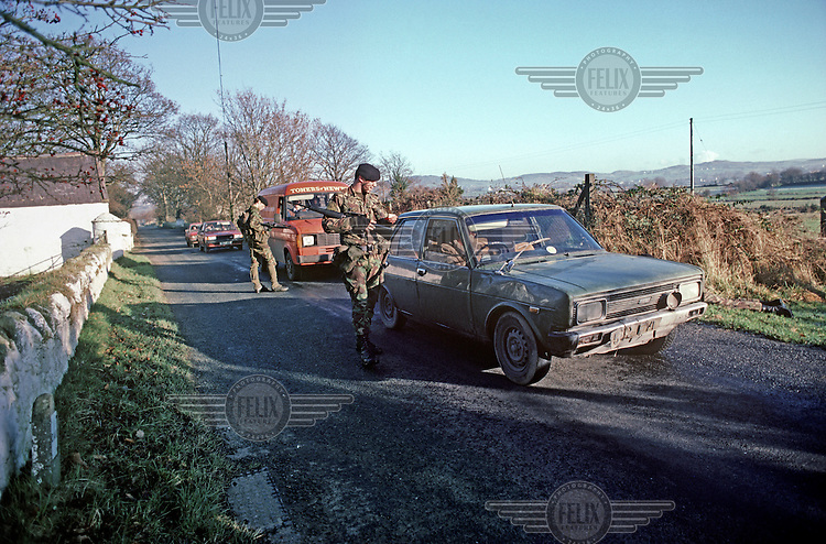 British Army soldiers check a vehicle near the border with the Republic of Ireland.