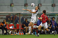 USA forward (20) Abby Wambach plays the ball in front of Norway defender (2) Ane Stangeland Horpestad. The United States (USA) defeated Norway (NOR) 4-1 during the third place match of the Women's World Cup China 2007 at Shanghai Hongkou Football Stadium in Shanghai, China, on September 30, 2007.