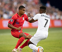 KANSAS CITY, KS - JUNE 26: Reggie Cannon #14 is challenged by Jose Fajardo #17 during a game between Panama and USMNT at Children's Mercy Park on June 26, 2019 in Kansas City, Kansas.