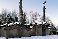 Haida Totem Poles and Plank Houses at Museum of Anthropology, University of BC (UBC), Vancouver, BC, British Columbia, Canada - Southwestern BC Region, Winter.  Traditional six-beam Haida Plank House (left) and Haida Mortuary House (right).