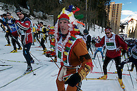 37th Engadin Ski Marathon at St. Moritz attracts 16,000 skiers in all kinds of attire that start at the far end of the frozen lake at Maloja and ski to St. Moritz.