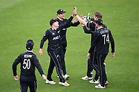 20th March 2021; Dunedin, New Zealand;  Blackcaps celebrate with Jimmy Neesham and Martin Guptill after the wicket of Mushfiqur Rahim during the New Zealand Black Caps v Bangladesh International one day cricket match. University Oval, Dunedin.