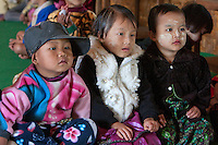 Myanmar, Burma.  Burmese Pre-school-age Children of Intha Ethnic Group, Inle Lake, Shan State.  Two have thanaka paste on their faces, a cosmetic sunscreen.