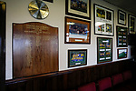 Team pictures and a board listing past officials in the Directors Lounge at the Look Local Stadium. Stocksbridge Park Steels v Pickering Town, Evo-Stik East Division, 17th November 2018. Stocksbridge Park Steels were born from the works team of the local British Steel plant that dominates the town north of Sheffield.<br /> Having missed out on promotion via the play offs in the previous season, Stocksbridge were hovering above the relegation zone in Northern Premier League Division One East, as they lost 0-2 to Pickering Town. Stocksbridge finished the season in 13th place.