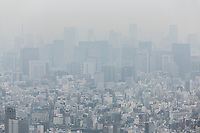 Heavy air pollution hangs over central Tokyo, viewed from the Tokyo Sky Tree.