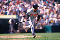 OAKLAND, CA - Roberto Alomar of the Baltimore Orioles bats during a game against the Oakland Athletics at the Oakland Coliseum in Oakland, California in 1996. Photo by Brad Mangin..