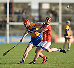 Niall Deasy of Clare in action against Richard Cahalane of Cork during their Munster Hurling League game at Cusack Park. Photograph by John Kelly.