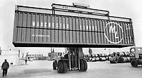 This is the way the cargo comes in 1973. In the world of cargo transportation this is the age of the container. This 40-ft. bigtimer is being moved from a ship at Pier 35 in Toronto harbor right on to a waiting truck. It carries up to 35 tons of goods. The container concept came on strongly in the 1960s. A new breed of ships was born; specially designed to carry containers; and many ports are vying to become container terminals. In Canada; most container business goes to Quebec; Maritimes.<br /> <br /> 1973<br /> <br /> <br /> PHOTO : Boris Spremo - Toronto Star Archives - AQP