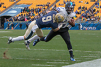 Pitt safety Ray Vinopal (9) tackles Duke quarterback Anthony Boone. The Duke Blue Devils defeated the Pitt Panthers 51-48 at Heinz Field, Pittsburgh Pennsylvania on November 1, 2014.