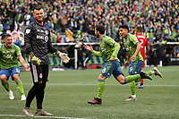 SEATTLE, WA - NOVEMBER 10: Victor Rodriguez #8 of the Seattle Sounders FC celebrates his goal with teammates Raul Ruidiaz #9 and Jordan Morris #13 as goalkeeper Quentin Westberg #16 shows his frustration during a game between Toronto FC and Seattle Sounders FC at CenturyLink Field on November 10, 2019 in Seattle, Washington.