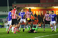Lincoln City's John Akinde under pressure from Exeter City's Christy Pym<br /> <br /> Photographer Chris Vaughan/CameraSport<br /> <br /> The EFL Sky Bet League Two - Lincoln City v Exeter City - Tuesday 26th February 2019 - Sincil Bank - Lincoln<br /> <br /> World Copyright © 2019 CameraSport. All rights reserved. 43 Linden Ave. Countesthorpe. Leicester. England. LE8 5PG - Tel: +44 (0) 116 277 4147 - admin@camerasport.com - www.camerasport.com