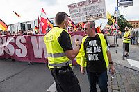 """Neonazis und Hooligans demonstrieren gegen Angela Merkel.<br /> Unter dem Motto """"Merkel muss weg"""" zogen ca. 1.200 am Samstag den 30. Juli 2016 mit einer Demonstration durch Berlin. Der Aufmarsch war vom einschlaegig bekannten Neonazi-Hooligan Enrico Stubbe angemeldet worden.<br /> Die Polizei hatte die Aufmarschroute der Rechten weitraeumig abgesperrt.<br /> Die Rechten forderten in Sprechchoeren immer wieder """"Nationalen Sozialismus! Jetzt!"""" (ein strafrechtlicher Trick, gemeint ist der Nationalsozialismus), beschimpften waehrend ihres Aufmarsches permanent Gegendemonstranten """"Wir kriegen euch alle"""" und """"Hurensoehne"""" und die Medienvertreter """"Luegenpresse"""". Mitarbeiter der Sicherheitsbehoerden erklaerten, dass es eindeutig ein rechtsextremer Aufmarsch gewesen sei bei dem sich keinerlei buergerliche Teilnehmer beteiligt haetten. Der Berliner Chef des Landesamt fuer Verfassungsschutz war persoenlich vor Ort um sich einen Eindruck zu verschaffen.<br /> Im Bild: Der Demonstrationsanmelder Enrico Stubbe als Ordner traegt ein T-Shirt mit dem Aufdruck """"Wir sind das Pack"""". Der Satz bezieht sich auf eine Aeusserung des SPD Vorsitzenden Gabriel, der eine rechtsradikale Meute, die in Heidenau ein Fluechtlingsheim angegriffen hat als """"Pack"""" bezeichnet hat.<br /> 30.7.2016, Berlin<br /> Copyright: Christian-Ditsch.de<br /> [Inhaltsveraendernde Manipulation des Fotos nur nach ausdruecklicher Genehmigung des Fotografen. Vereinbarungen ueber Abtretung von Persoenlichkeitsrechten/Model Release der abgebildeten Person/Personen liegen nicht vor. NO MODEL RELEASE! Nur fuer Redaktionelle Zwecke. Don't publish without copyright Christian-Ditsch.de, Veroeffentlichung nur mit Fotografennennung, sowie gegen Honorar, MwSt. und Beleg. Konto: I N G - D i B a, IBAN DE58500105175400192269, BIC INGDDEFFXXX, Kontakt: post@christian-ditsch.de<br /> Bei der Bearbeitung der Dateiinformationen darf die Urheberkennzeichnung in den EXIF- und  IPTC-Daten nicht entfernt werden, diese sind in digitalen Medie"""