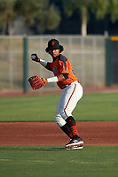 AZL Giants Orange third baseman Luis Toribio (22) throws to first base during an Arizona League game against the AZL Mariners on July 18, 2019 at the Giants Baseball Complex in Scottsdale, Arizona. The AZL Giants Orange defeated the AZL Mariners 7-4. (Zachary Lucy/Four Seam Images)
