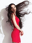 Japanese woman in red dress with waist long flying black hair on white background Image © MaximImages, License at https://www.maximimages.com