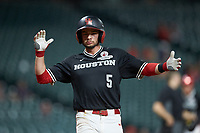 Connor Hollis (5) of the Houston Cougars celebrates as he crosses home plate after hitting a home run against the Mississippi State Bulldogs in game six of the 2018 Shriners Hospitals for Children College Classic at Minute Maid Park on March 3, 2018 in Houston, Texas. The Bulldogs defeated the Cougars 3-2 in 12 innings. (Brian Westerholt/Four Seam Images)