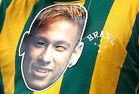 A Neymar mask hangs on the shirt of a Brazil fan