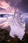 Jokulsarlon Lagoon reaches a depth of 100 meters and is located southeast of Vatnajokull Glacier (8,400 sq. km), the largest glacier in Iceland. The lagoon is full of floating icebergs.