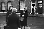 Three middle aged women talking in their street.  London England 1976 1970s UK
