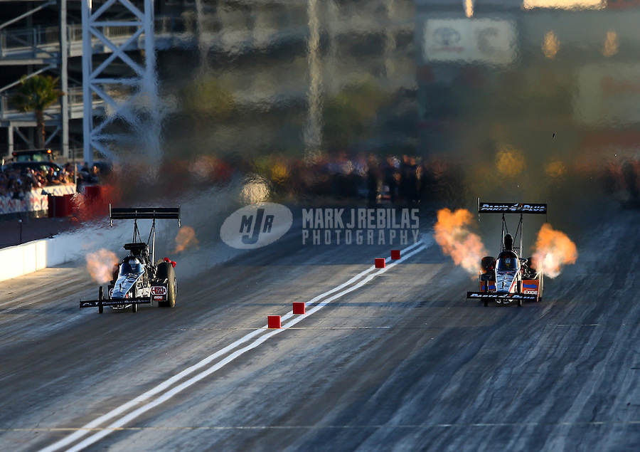Mar 28, 2014; Las Vegas, NV, USA; NHRA top fuel dragster driver Clay Millican (right) races alongside Bob Vandergriff Jr during qualifying for the Summitracing.com Nationals at The Strip at Las Vegas Motor Speedway. Mandatory Credit: Mark J. Rebilas-