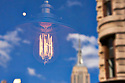 The Empire State Building reflected in a shop window with an illuminated lightbulb  New York USA