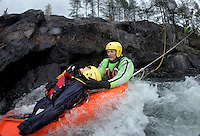 Norwegian Air Ambulance training area Camp Torpomoen. Pilots, doctors and rescue paramedics practice various skills during a week of coordinated training. River rescue training Rescue paramedic Espen Somdalen Witzøe