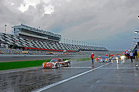 The cars roll off in the rain.