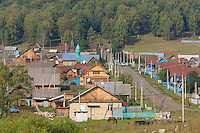 The village of Gadel-Gareyéro, population 400, where half the men practice beekeeping. A hundred or so Isbas, made from pine trunks, with brightly colored windows make up the village, surrounded by forests of oak, birches, aspen, maple and linden trees.
