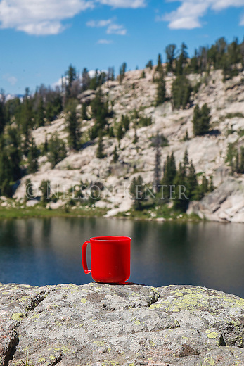 red coffee cup and mountain lake in the red coffee cup and mountain lake
